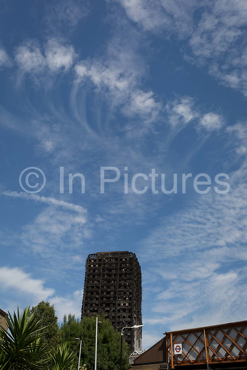 Two weeks after the devastating fire that killed an unspecified number of people in Grenfell Tower, the charred and blackened tower block remains a crime scene, on 26th June 2017, in the London borough of Kensington & Chelsea, England.