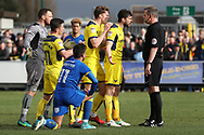 Oxford United players arguing with ref after the award of a penalty during the EFL Sky Bet League 1 match between AFC Wimbledon and Oxford United at the Cherry Red Records Stadium, Kingston, England on 10 March 2018. Picture by Matthew Redman.