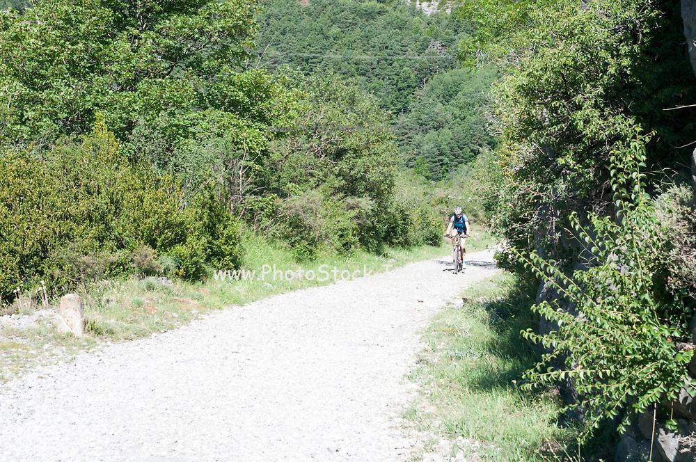cyclist at Fuerte de Sta Elena (The fort at Santa Elena), Pyrenees Mountains, Huesca province, Aragon, Spain
