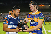 Auckland captain TJ Faiane pictured being presented with the  John Drake Boot by Bay of Plenty captin Aidan Ross after the Mitre 10 Cup match played at Rotorua International Stadium in Rotorua on Friday 2nd October 2020.<br /> Copyright photo: Alan Gibson / www.photosport.nz