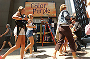 Workers from Caselli Erectors put up signage for the new musical The Color Purple outside the Broadway Theater in Manhattan, NY. Workers are Richie Harding, bald, John Mantakis, navy shirt with brown hair, and Anthony Lezama is in white shirt, brown hair. 7/26/2005 Photo by Jennifer S. Altman