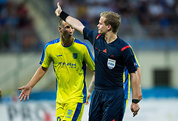 Uros Korun of Domzale arguing with referee Bart Vertenten of Belgium after he show penalty shot during 1st Leg football match between NK Domzale (SLO) na FC Cukaricki (SRB) in 1st Round of Europe League 2015/2016 Qualifications, on July 2, 2015 in Sports park Domzale,  Slovenia. Photo by Vid Ponikvar / Sportida