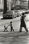 A mother and child walk through Atlanta's Techwood Homes public housing project during the period when Atlanta's children were being abducted and killed.