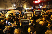 """French and Jews come together to make a vigil outside a Kosher supermarket in Porte Vincennes, Paris, France. They hold the names of the hostages who were killed the day before. Yesterday this Kosher supermarket was the scene of a hostage taking and followed by an armed shoot out between Jihadist gunmen and French police. It ended in a shoot out and with the death of the terrorists. Some hostages were killed and police injured.<br /><br />This event was directly linked to the attack on the offices of Charlie Hebdo, killing twelve people, including the editor and celebrated cartoonists two days before. This week was the deadliest week of terror attacks in France for over fifty years. Charlie Hebdo is a satirical publication well known for its political cartoons. <br /><br />As a solidarity actions with the deaths at Charlie Hebdo many placards read """"Je suis Charlie"""" translating as """"I am Charlie (Hebdo)"""". Demonstrators held aloft pens, brushes and crayons, symbolizing the profession of journalists and cartoonists who were killed."""