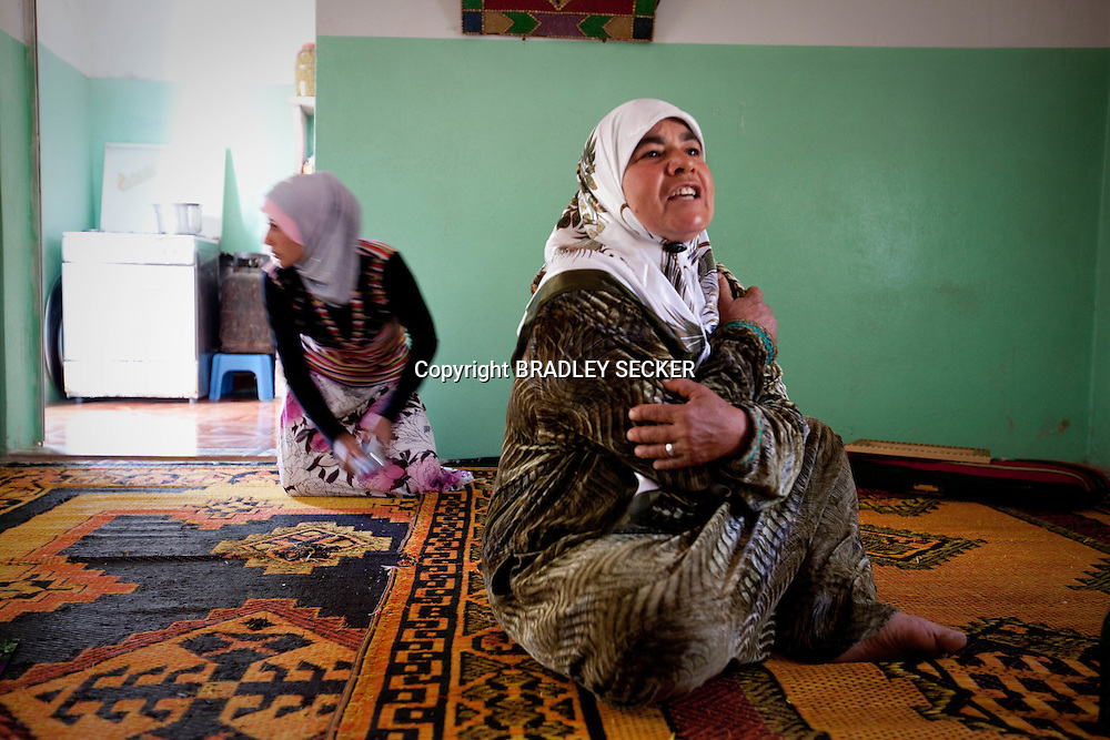 A villager from Idlib describes how the Syrian army and shabiha militia attacked her village of Basheria, and killed her fifteen year old son as he fled into the surrounding mountains. Basheria, Idlib, Syria 14/06/2012