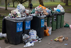 © Licensed to London News Pictures. 31/03/2021. London, UK. Overflowing bins in Greenwich Park after hundreds of people visited the park to enjoy sunny weather and take advantage of new lockdown rules that allow groups of six to meet outside. Photo credit: George Cracknell Wright/LNP