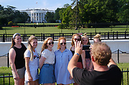 WASHINGTON - JUNE 30, 2019: Visitors take photos of themselves in front of The White House from The Ellipse on June 30, 2019, in Washington, D.C.