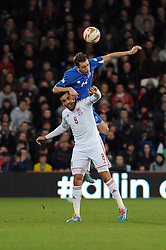 Hal Robson-Kanu of Wales (Reading) challenges for the ball with Kari Arnson (Rotherham United) of Iceland - Photo mandatory by-line: Dougie Allward/JMP - Tel: Mobile: 07966 386802 03/03/2014 -