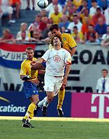 Ruud Van Nistelrooy<br /> Holland Euro 2004<br /> Tobias Linderoth Sweden<br /> Sweden v Holland 26/06/04 Quarter Finals  <br /> EURO 2004 PORTUGAL<br /> Photo Robin Parker Digitalsport
