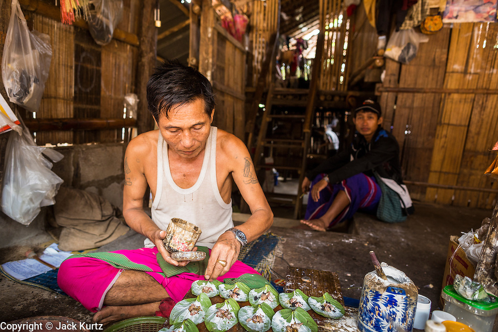 22 MAY 2013 - MAELA REFUGEE CAMP, TAK, THAILAND: The owner of a snack stand makes betel nut leaves for customers. Burmese chew betel, which has a slightly stimulative effect. Mae La (Maela) is the largest refugee camp for Burmese in Thailand. Over 90% are ethnic Karen. It was established in 1984 in Tha Song Yang District, Tak Province in the Dawna Range area and currently houses 40,000 refugees. The Thai government has indicated that it would like to close the camp and repatriate the refugees to Myanmar as soon as the political situation in Myanmar is stable enough.   PHOTO BY JACK KURTZ