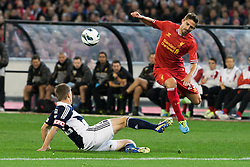 © Licensed to London News Pictures. 24/7/2013. Fabio Borini gets tackled  during the Melbourne Victory Vs Liverpool F.C at the Melbourne Cricket Ground, Melbourne, Australia. Photo credit : Asanka Brendon Ratnayake/LNP