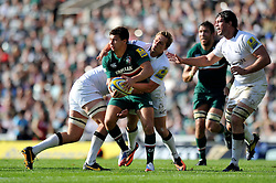 Leicester Tigers scrum half Ben Youngs is tackled in possession - Photo mandatory by-line: Patrick Khachfe/JMP - Tel: Mobile: 07966 386802 - 21/09/2013 - SPORT - RUGBY UNION - Welford Road Stadium - Leicester Tigers v Newcastle Falcons - Aviva Premiership.