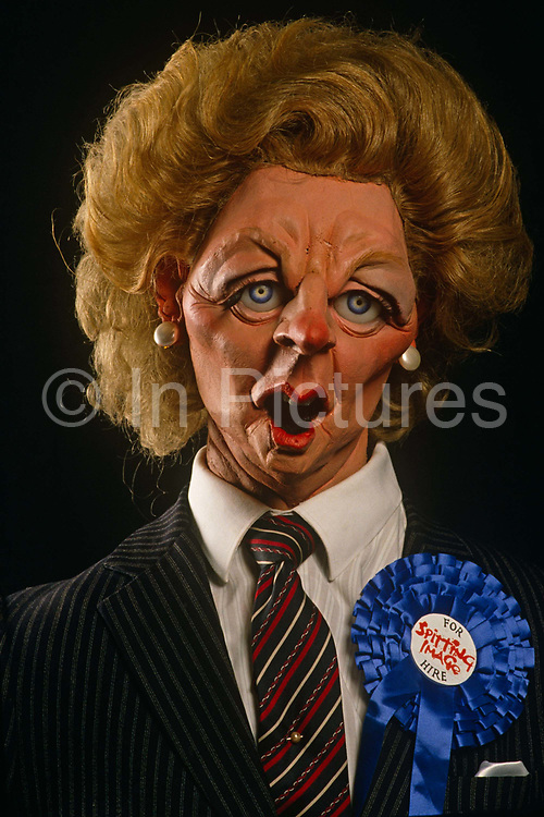 A satirical Margaret Thatcher Spitting Image puppet by Fluck and Law wears a blue Conservative rosette and For Hire sticker. Thatcher died on April 8th 2013 after suffering a stroke while staying in the Ritz Hotel, London.