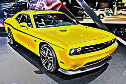08 February 2012:  2012 Dodge Challenger SRT8 Yellow Jacket with 392 Hemi. The Charger SRT8 comes with a new 6.4 liter HEMI V8 delivering more horsepower and torque than the 6.1 liter HEMI V8 it replaces. Estimated power ratings for the 2012 Dodge Charger SRT8 are 465 horsepower and 569Nm of torque. Specific horsepower and torque numbers will be announced closer to the vehicle introduction. The standard paddle-shift technology joins the standard AutoStick on the floor shifter. Both are mated to the W5A580 five-speed automatic transmission. Chicago Auto Show, Chicago Automobile Trade Association (CATA), McCormick Place, Chicago Illinois This image was produced in part utilizing High Dynamic Range (HDR) or panoramic stitching or other computer software manipulation processes. It should not be used editorially without being listed as an illustration or with a disclaimer. It may or may not be an accurate representation of the scene as originally photographed and the finished image is the creation of the photographer.