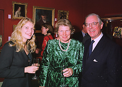 Left to right, MISS SOPHIA SPINK and her parents MR & MRS ANTHONY SPINK of the Spink antique dealer family,  at an exhibition in London on 12th November 1997.MDF 50