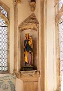 Interior historic village parish church, Wingfield, Suffolk, England, UK statue blessed Virgin Mary