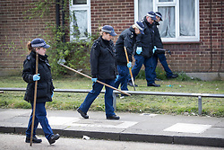 © Licensed to London News Pictures. 12/04/2017. London, UK. Police conduct a search near an alleyway off Newnham Close where a 19 year old man, named locally as Abdullahi Tarabai,  was murdered yesterday after reportedly being chased though a housing estate in Northolt. This is the second fatal stabbing in the capital in 24 hours. The location is adjacent to a gun siege from October 2016. Four men have been arrested Photo credit: Peter Macdiarmid/LNP