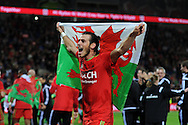 Gareth Bale of Wales celebrates  after the match as the Wales team qualify for Euro 2016 finals in France.  Wales v Andorra, Euro 2016 qualifying match at the Cardiff city stadium  in Cardiff, South Wales  on Tuesday 13th October 2015. <br /> pic by  Andrew Orchard