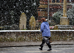 © Licensed to London News Pictures. 14/01/2013. Chalfont St Peter, UK People and snow in Chalfont St Peter in south-east Buckinghamshire. Snow hits the many parts of the UK today 14th January 2013. Photo credit : Stephen Simpson/LNP