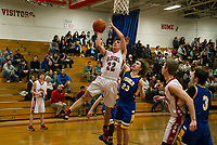 Laconia's Joey Lennon takes a shot to the basket with Franklin's Jakob Beaupre during NHIAA division III basketball Tuesday evening.  (Karen Bobotas/for the Laconia Daily Sun)