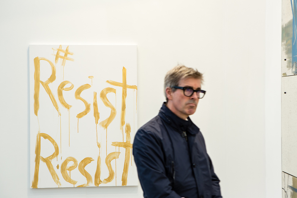 "New York, NY - 5 May 2017. The opening day of the Frieze Art Fair, showcasing modern and contemporary art presented by galleries from around the world, on Randall's Island in New York City. An example of political art, ""#ResistResist"" by Kim Gordon, in the 303 Gallery."