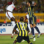 S.B. Elazigspor's and Fenerbahce's players Moussa Sow, Egemen Korkmaz (R) are in action with ball during their Turkish superleague soccer match S.B. Elazigspor between Fenerbahce at the Ataturk stadium in izmir Turkey on Saturday 18 August 2012. Photo by TURKPIX