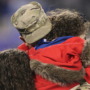 Air Force Tech. Sgt. David H. Brenhuber, of Cherry Hill, N.J. who is serving in Afghanistan, hugs his wife Tammy and daughter Alexis after a surprise reunion during the first half of the New York Giants Vs Green Bay Packers, NFL American Football match at MetLife Stadium, East Rutherford, New Jersey, USA. 17th November 2013. Photo Tim Clayton