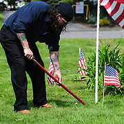 "BATH -- 5/25/15 - Richard Harvey of Wiscasset prepares the area around the Library Park Memorial before Memorial Day ceremonies on Monday. Harvey, who is not a veteran himself, honors those who served and fell as part of the ""We Remember Committee."" He works to keep the memories of fallen service members alive. <br /> The Memorial Day Parade in Bath took place as a result of an anonymous donor who gave $5,000 and the American Legion who donated $3,000 to pay for the parade in Bath. The Elks Club supported the parade in prior years but were unable to do so this year, leaving organizers without a funding source close to the parade date.  <br /> Photo ©2015 by Roger S. Duncan / For the Forecaster."