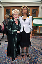 Left to right, GLORIA HUNNIFORD and LORNA PONTI at 'Lunch for Life' in aid of Marie Curie Cancer Care held at Wentworth Golf Club, Berkshire on 2nd march 2009.