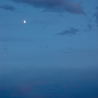 The moon hovers over mountains in the Gobi Desert, near Dalanzadgad, Mongolia.