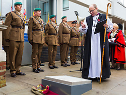The stone is blessed by a member of the local clergy as The London Borough of Haringey and representatives of the Armed Forces honour Lieutenant-Colonel Sir Brett Mackay Cloutman VC MC KC with the unveiling of the final London Victoria Cross Commemorative paving stone in Hornsey, London. November 06 2018.