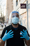 "April, 10th 2020 - Paris, Ile-de-France, France: Supermarket workers wearing a range of masks and facial coverings in the hope of protecting themselves from the spread of the Coronavirus, during the end of the first month of near total lockdown imposed in France. A week after President of France, Emmanuel Macron, said the citizens must stay at home for at least 15 days, that has been extended. He said ""We are at war, a public health war, certainly but we are at war, against an invisible and elusive enemy"". All journeys outside the home unless justified for essential professional or health reasons are outlawed. Anyone flouting the new regulations is fined. Nigel Dickinson"