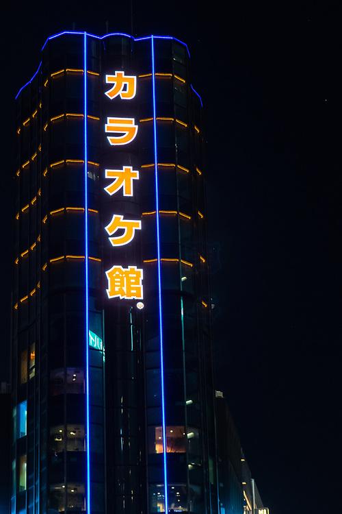 Neon high rise building in Shinjuku.