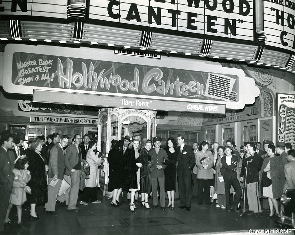 1944 Actor Robert Hutton joins a crowd during the premiere of the Hollywood Canteen at Warner Bros. theater