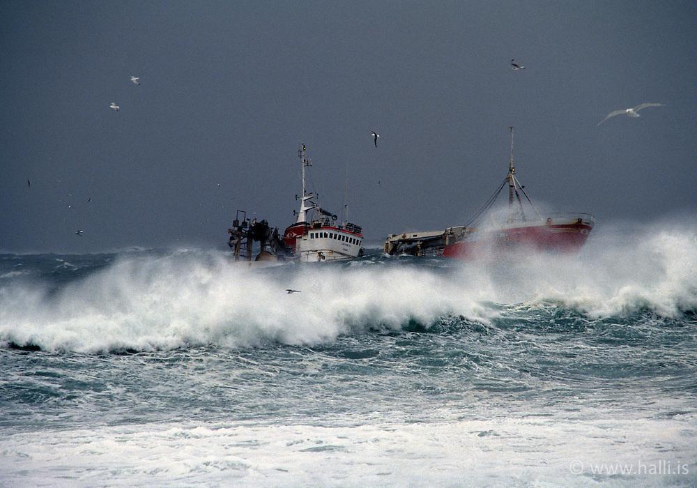 Fishing boat fighting against rough sea in Grindavik, Iceland - Skip í brimgarðinum við Grindavík