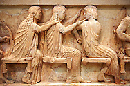 Treasury of Siphnos East Frieze representing scenes from the Trojan War. 525 b.C. .From Left: Aris, Afrodite, Artemis. Delphi Archaeological Museum. .<br /> <br /> If you prefer to buy from our ALAMY STOCK LIBRARY page at https://www.alamy.com/portfolio/paul-williams-funkystock/greco-roman-sculptures.html . Type -    Delphi     - into LOWER SEARCH WITHIN GALLERY box - Refine search by adding a subject, place, background colour, museum etc.<br /> <br /> Visit our ANCIENT GREEKS PHOTO COLLECTIONS for more photos to download or buy as wall art prints https://funkystock.photoshelter.com/gallery-collection/Ancient-Greeks-Art-Artefacts-Antiquities-Historic-Sites/C00004CnMmq_Xllw