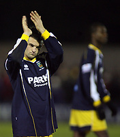 Photo: Paul Thomas.<br /> Bury v Weymouth. The FA Cup. 21/11/2006.<br /> <br /> Dejected Weymouth goal scorer Stephen Tully thanks his travelling fans.