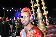 Israel, Acre, Man in traditional clothes sells tamarind juice
