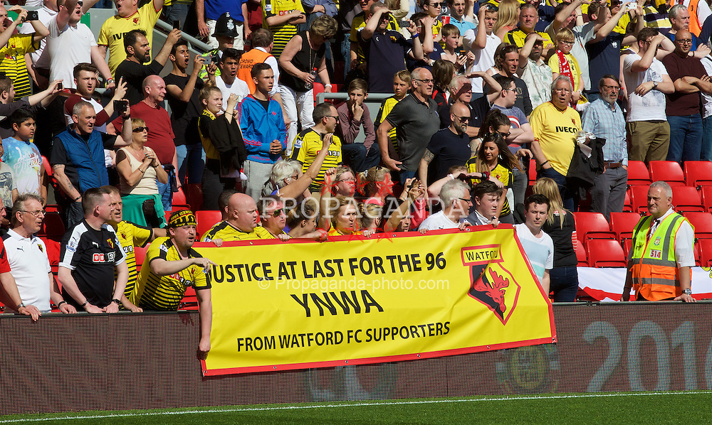 LIVERPOOL, ENGLAND - Sunday, May 8, 2016: Watford fans show messages of support for the Hillsborough victims during the Premier League match at Anfield. (Pic by David Rawcliffe/Propaganda)