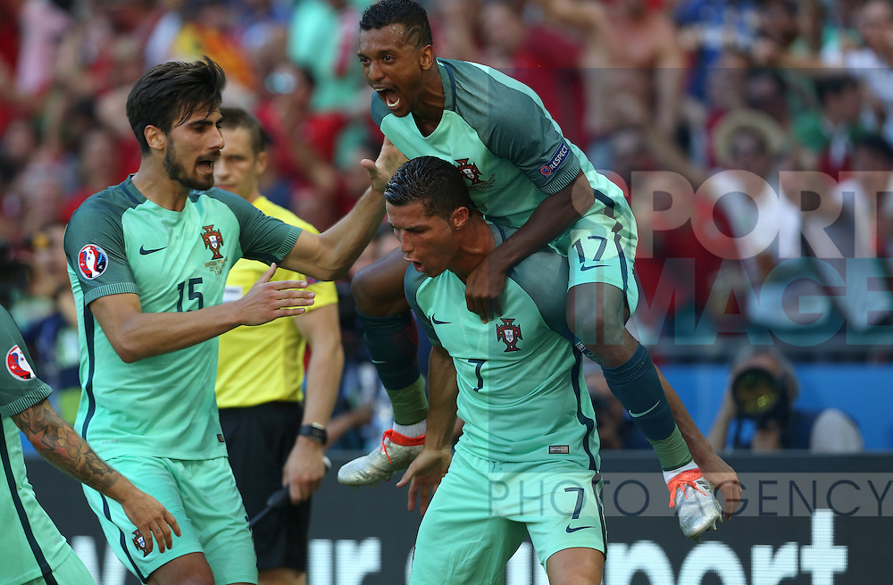 Cristiano Ronaldo of Portugal celebrates scoring his sides second goal during the UEFA European Championship 2016 match at the Stade de Lyon, Lyon. Picture date June 22nd, 2016 Pic Phil Oldham/Sportimage
