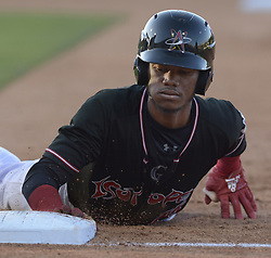May 22, 2018 - U.S. - ASEC -- The Isotopes' Raimel Tapia dives safely bak to 1st base the game against Salt Lake in Isotopes Park on Tuesday, May 22, 2018. (Credit Image: © Greg Sorber/Albuquerque Journal via ZUMA Wire)