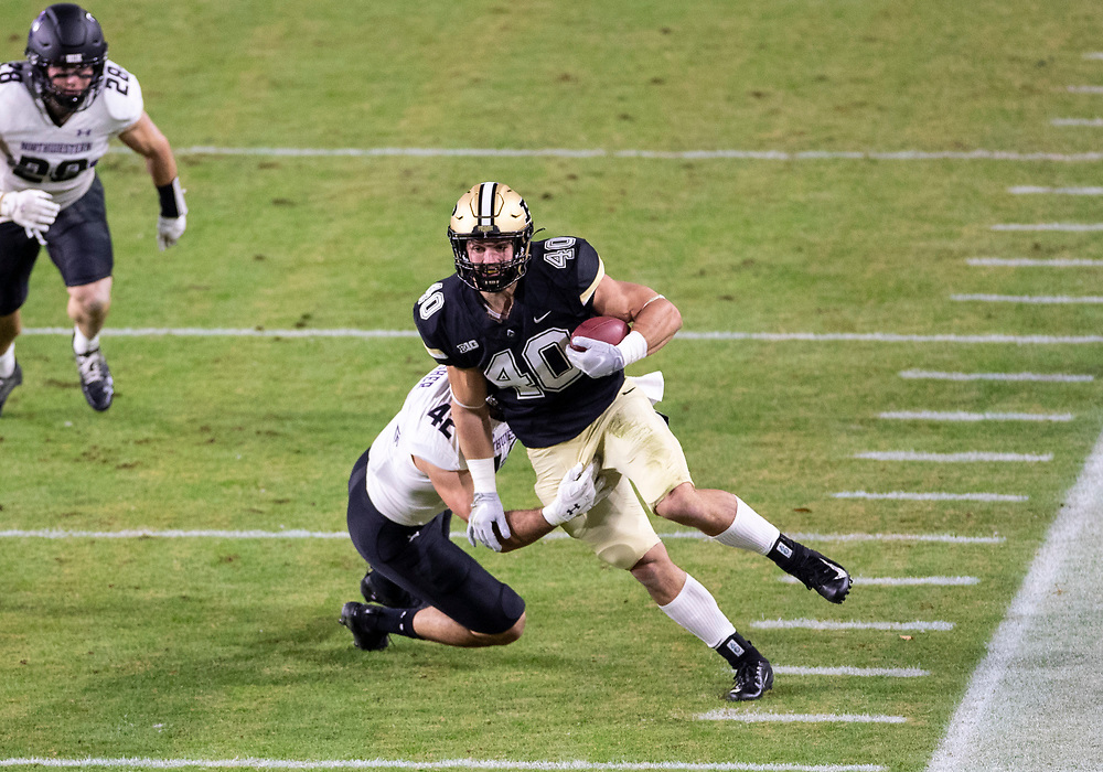 November 14, 2020:  Purdue running back Zander Horvath (40) runs with the ball as Northwestern linebacker Paddy Fisher (42) attempts to make the tackle during NCAA football game action between the Northwestern Wildcats and the Purdue Boilermakers at Ross-Ade Stadium in West Lafayette, Indiana. Northwestern defeated Purdue 27-20.  John Mersits/CSM.