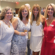 Left to right Emily Berry, Debby McDowall, Lindsay Wilharm, and Kathryn Wilson pose for a photo Saturday September 20, 2014 during the 4th Annual Care Project Gala at Union Station in Wilmington, N.C. (Jason A. Frizzelle)