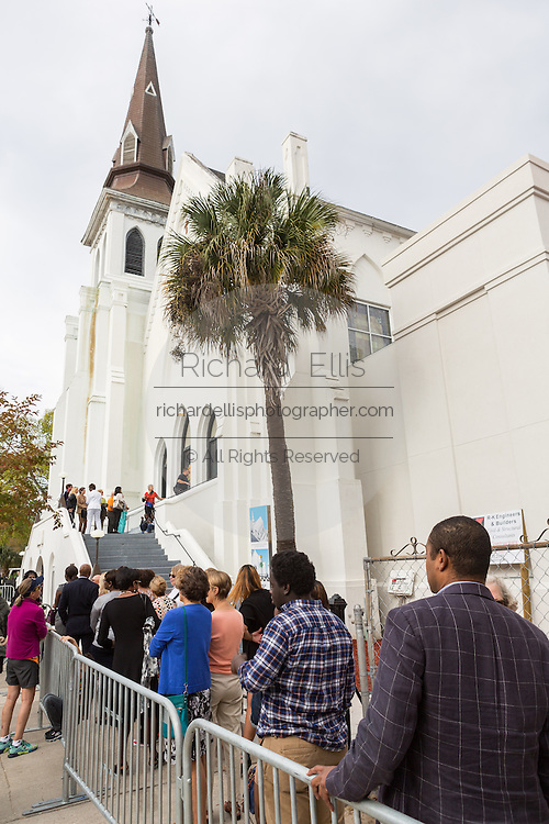 People line up outside the historic Mother Emanuel AME Church to hear superstar Pharrell Williams perform with the Gospel Choir during Sunday service November 1, 2015 in Charleston, South Carolina. The church was the site of the mass shooting that killed nine-people in June 2015 and will be featured is part of a program on race relations being produced by A+E Networks.