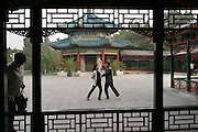 In Beijing's Forbidden City a middle-aged couple in Zhongshan Park practices ball room dancing to recorded music. Nearby, hundreds of people practice the long-standing tradition of morning group dance and more traditional Chinese exercise. (Supporting image from the project Hungry Planet: What the World Eats)