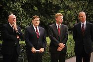 The Bush 41 team:  Marlin Fitzwater, John Sununu, VP Dan Quayle, James Baker III watching a ceremony for released hostage Robert Polhill..Photograph by Dennis Brack bb25
