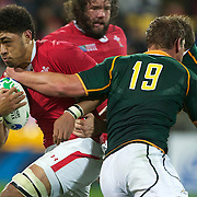 Toby Faletau, Wales, (left) is tackled by Johann Muller, South Africa, during the Wales V South Africa, Pool D match during the Rugby World Cup in Wellington, New Zealand,. 11th September 2011. Photo Tim Clayton