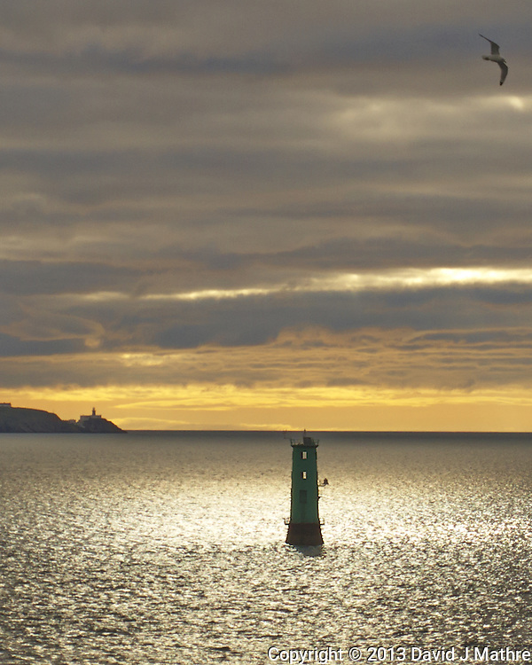 Morning View of the North Bull Lighthouse at the Entrance to Dublin Harbor With the Bailey Lighthouse at Howth iin the Distance. Image taken with a Leica V-Lux 6 camera (ISO 100, 17.7 mm, f/2.8, 1/1600 sec). Semester at Sea Spring 2013 Enrichment Voyage.