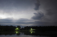 Middletown, New York - Lightning streaks across the sky and is reflected in the lake at Fancher-Davidge Park during a thunderstorm on the night of Aug. 1, 2011.