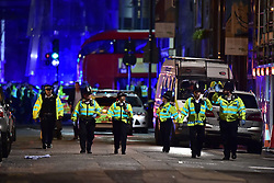"""Police officers on Borough High Street as police are dealing with a """"major incident"""" at London Bridge."""